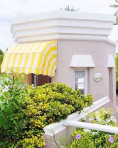 yellow and white striped awning