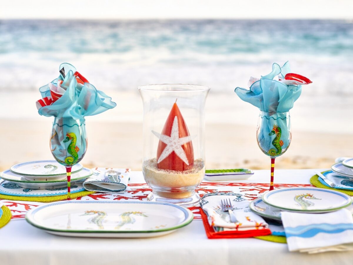 Festive beach themed gifts on a table set with Barbara Finsness's Bermuda designs